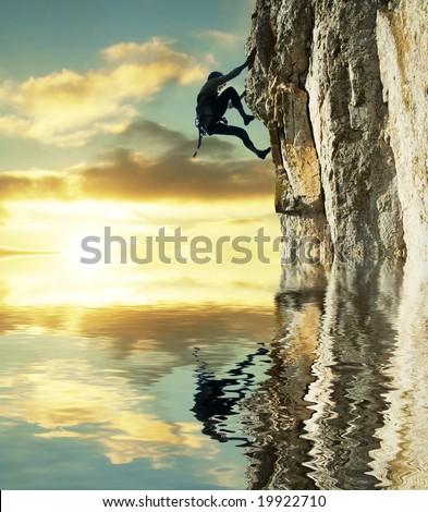 girl climbing on the rock - stock photo