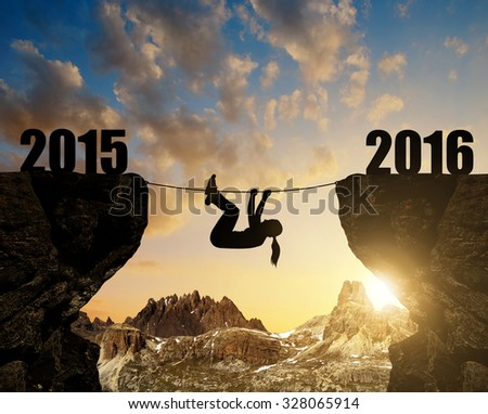 Girl climbs into the New Year 2016.   - stock photo