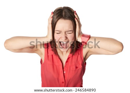 Girl closing ears with hands and screaming, isolated on white - stock photo