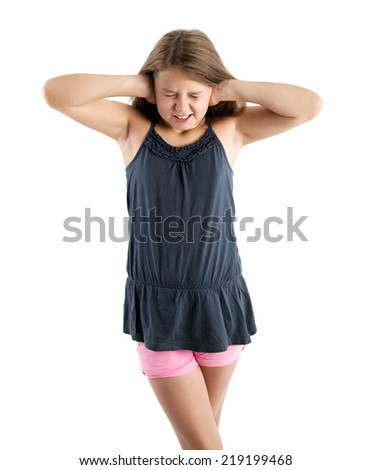 girl closing her ears with hands - stock photo