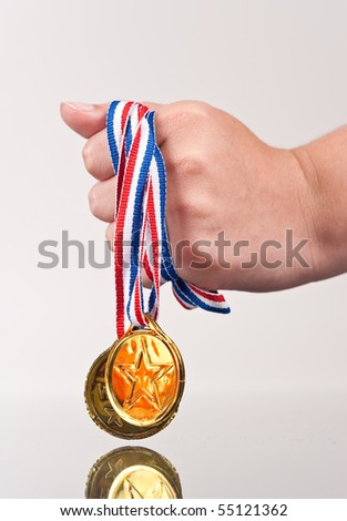 Girl Clutching Victory Gold Medals - stock photo