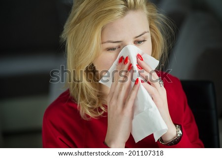 Girl cold flu illness tissue blowing runny nose or allergy - stock photo