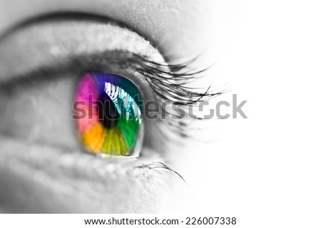 Girl colorful and natural rainbow eye on white background - stock photo