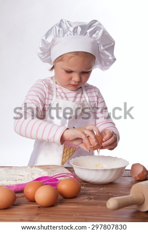 Girl cook prepares a pie - stock photo