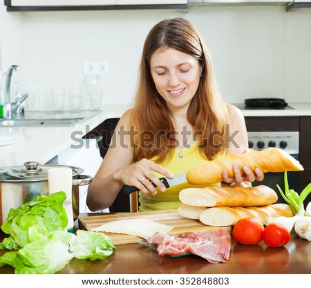 Girl cooking spanish sandwiches  in home kitchen