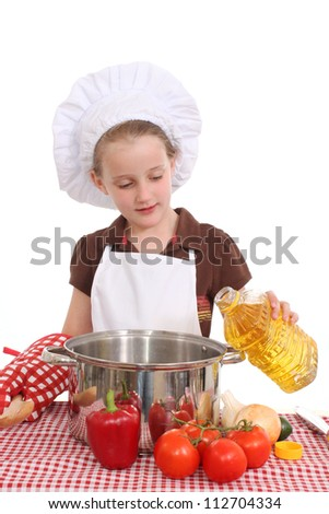 Girl cooking with oil - stock photo
