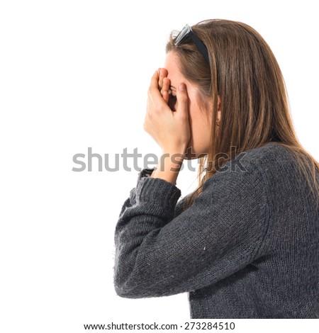 Girl covering her eyes  - stock photo