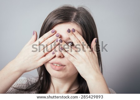 girl covering her eyes with her hands