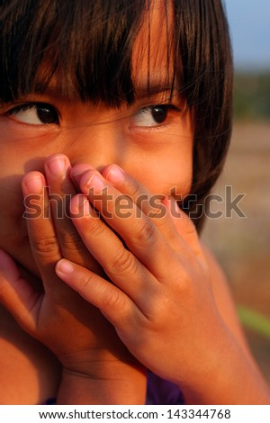 girl covering her mouth and nose with her hands - stock photo
