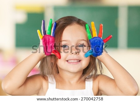 Girl. Cute smiling little girl with hands in paint isolated - stock photo
