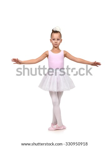 girl dances ballet in her ballerina tutu, isolated on white