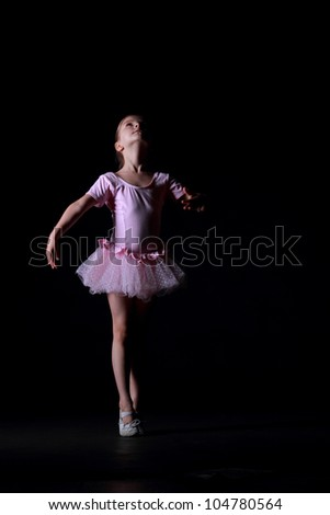 girl dances in a pretty white dress on a dark background - stock photo