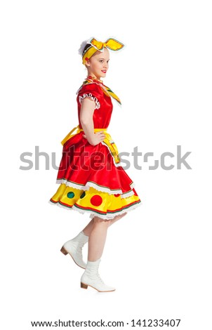 Girl dances in national russian dresses on white background.