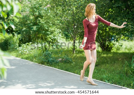 girl dancing in the yard