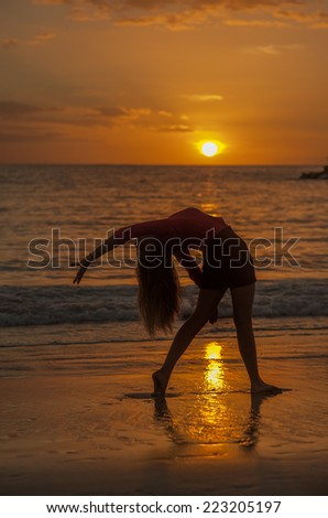 Girl dancing on the sunset