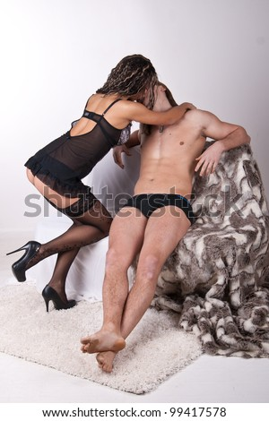 girl dancing striptease naked guy - stock photo