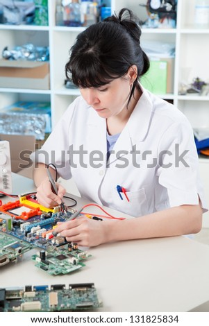 Girl debugging an electronic precision device