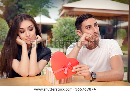 Girl Disappointed on Her Valentine Gift From Boyfriend - Unhappy girlfriend receiving bad gift from the man she loves