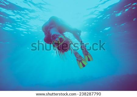 girl dive, underwater scene, vintage style - stock photo