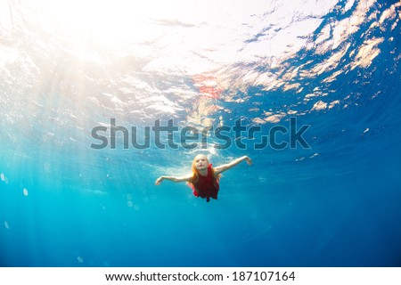 girl diving under the sea - stock photo