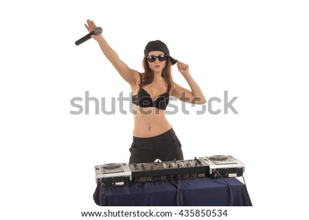 Girl DJ in the black bra is singing and touching her cap - stock photo