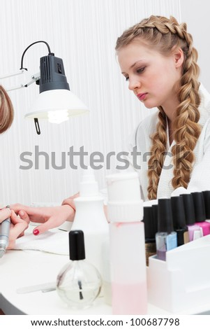 girl doing a manicure at the beauty salon