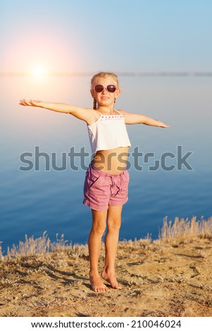 girl doing exercises on the beach - stock photo