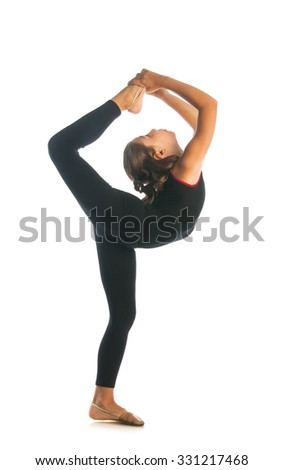 Girl doing gymnastic exercise isolated on white background - stock photo