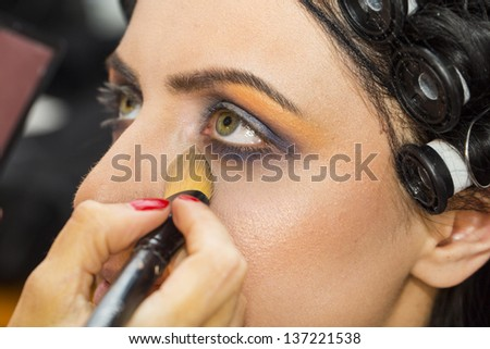 girl doing makeup in the salon