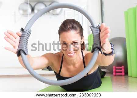 girl doing pilates with ring - stock photo