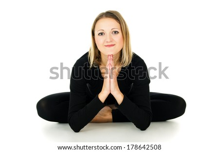 Girl doing stretching exercise and relaxation - stock photo
