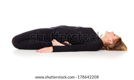girl doing stretching exercises lying - stock photo