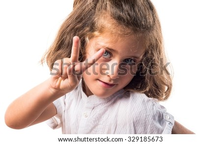 Girl doing victory gesture