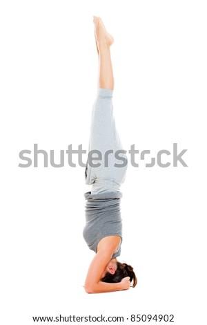 girl doing yoga exercise on floor. isolated on white background - stock photo