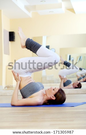 girl doing yoga exercises