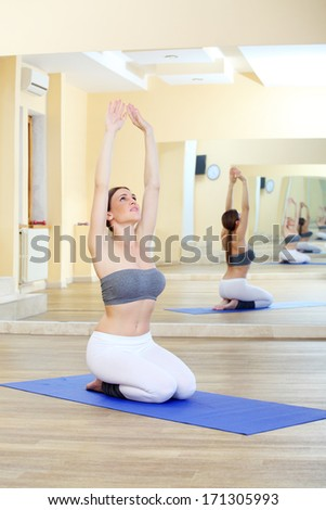 girl doing yoga exercises in the gym 2