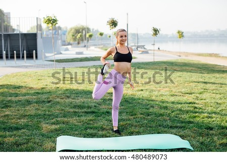 Girl doing yoga fitness exercise for relax and healthy at lake in morning, Nature background. Concept outdoor sport and health.