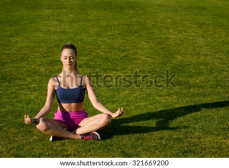 Girl doing yoga on the nature. Morning yoga class. Meditation on the nature. - stock photo