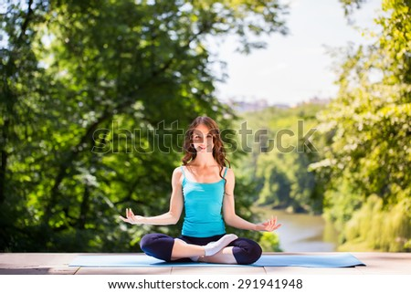 Girl doing yoga outdoors.