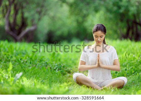 Girl doing yoga outdoors
