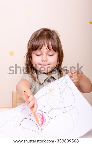 girl drawing colorful bug with marker - stock photo
