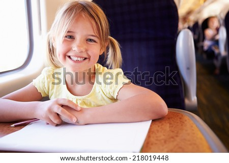 Girl Drawing Picture On Train Journey - stock photo