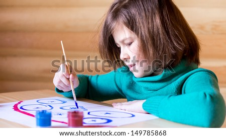 girl draws paints with enthusiasm - stock photo