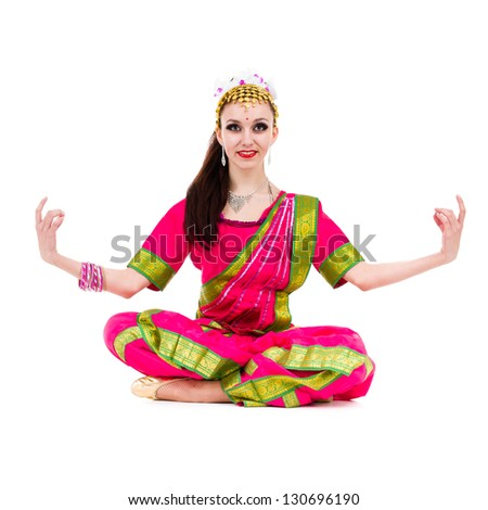 girl dressed in Indian costume with yoga pose.  Isolated on white background in full length..