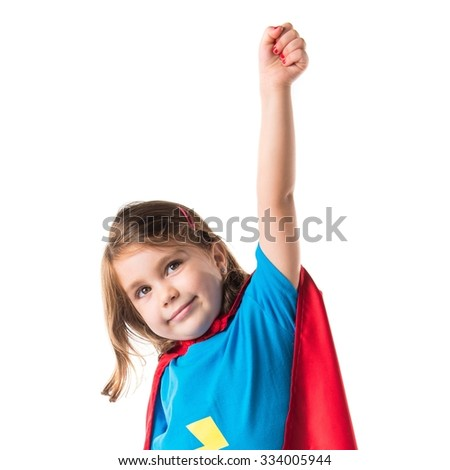 Girl dressed like superhero making fly gesture - stock photo