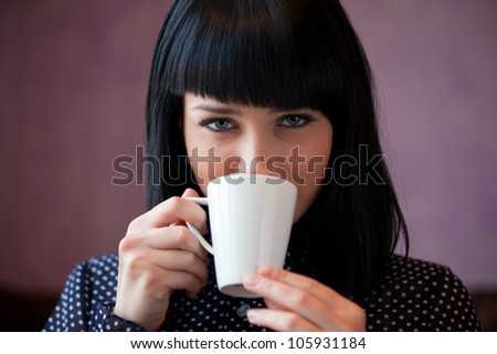 girl drink coffee close up portrait - stock photo