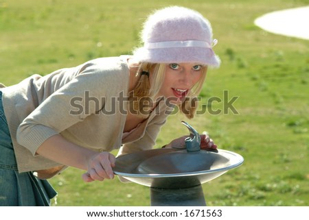 girl drinking - stock photo
