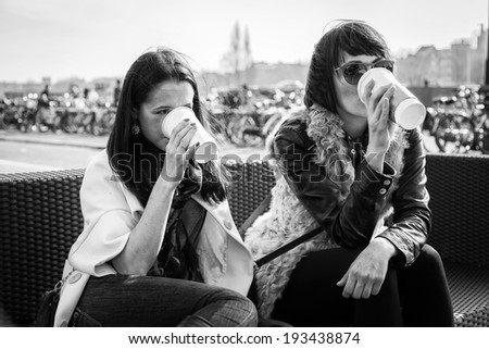 girl drinking coffee on the street - stock photo