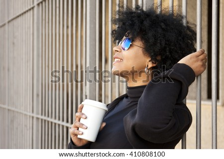 girl drinking coffee on the street