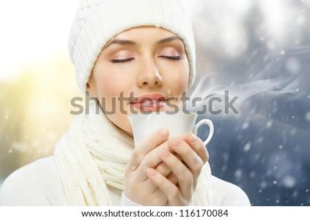 girl drinking hot coffee - stock photo